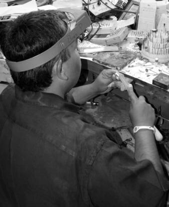 Eliseo Pulido working at his Jewelry work bench